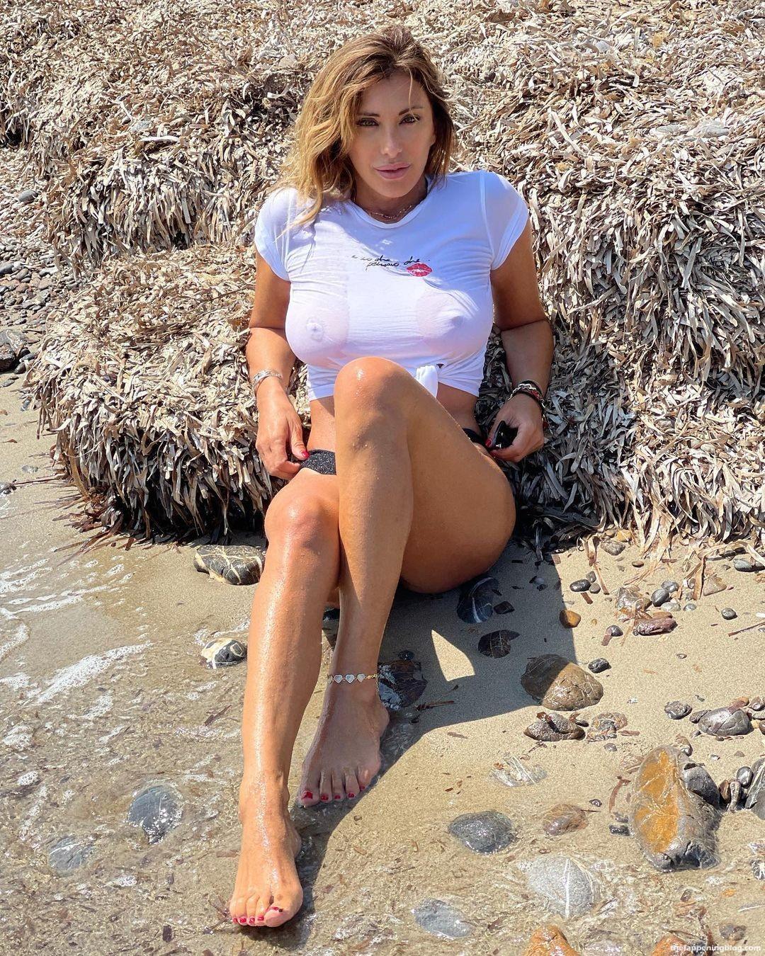 Sabrina Salerno Displays Her Nude Tits (6 Pics)